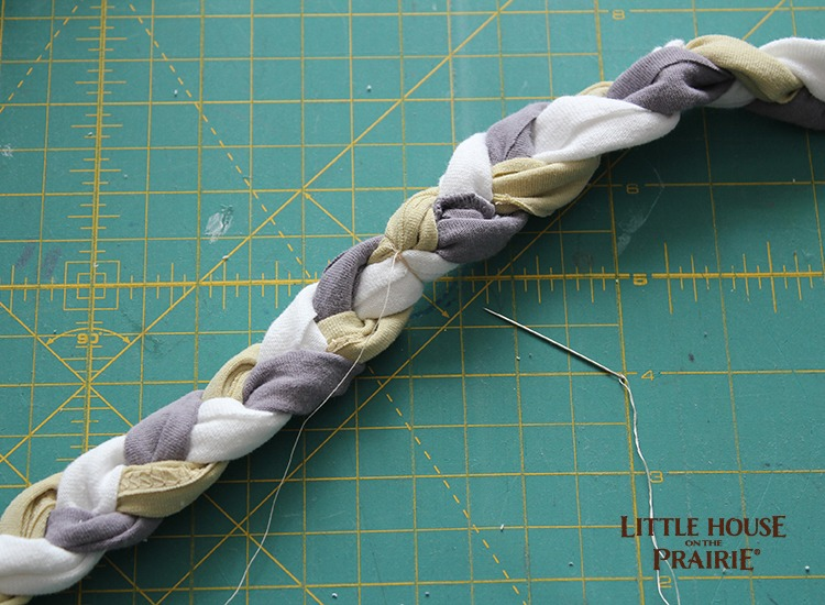 Use needle and thread to make a clean edge