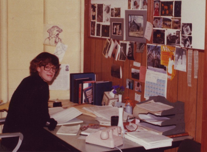 Pamela Smith Hill at work as a public information specialist for the South Dakota Division of Tourism in 1979. She began writing professionally about Laura Ingalls Wilder while working here. There's an image of the Ingalls girls taped to the wall, just to the right of the Ms. magazine cover.