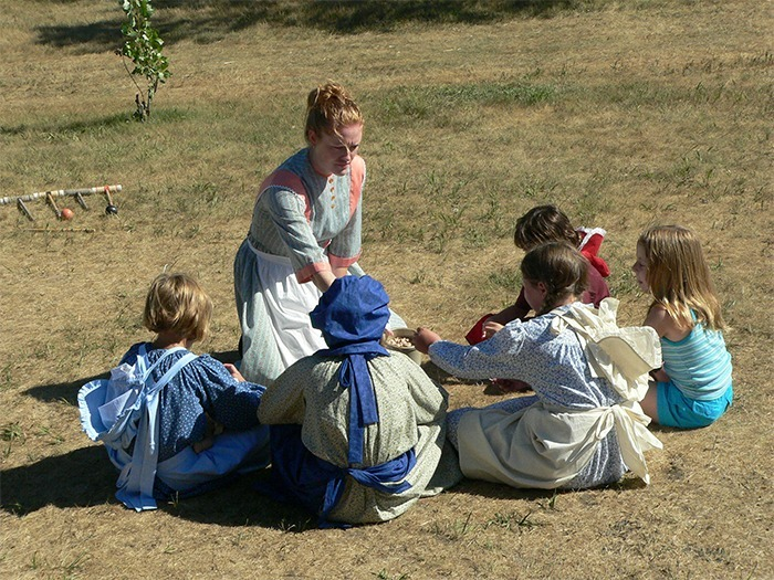 Playing pioneer games at the Ingalls Homestead.