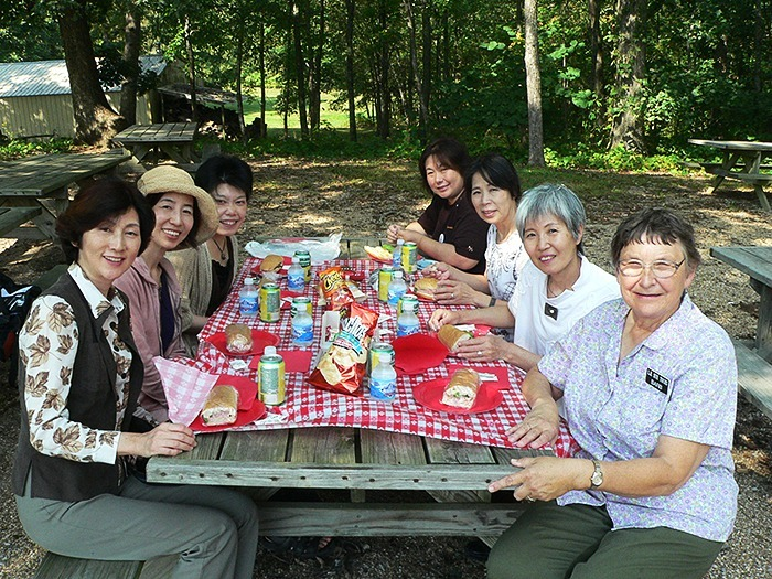 Tour group from Japan enjoying a picnic in Mansfield, MO.