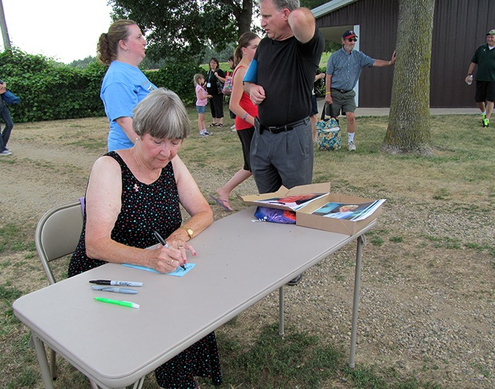 "Charlotte Stewart, Miss Beadle from the TV show ""Little House on the Prairie,"" signs autographs at Walnut Grove at LauraPalooza"