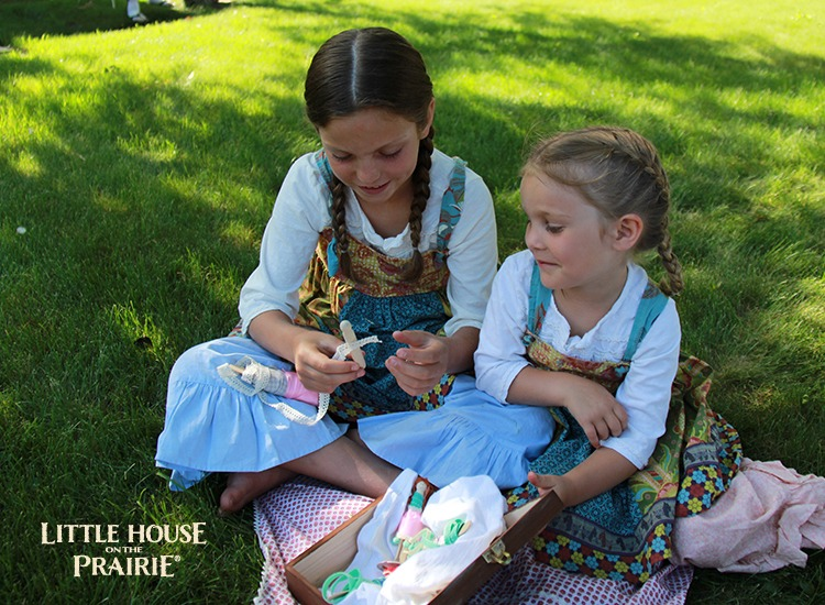 Making clothespin dolls with scraps of fabric and ribbon trim - Little House on the Prairie inspired crafts!