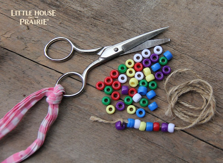 Little House on the Prairie Inspired Craft - stringing beads and buttons hands on activity