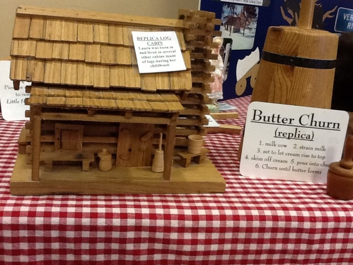 Butter churcn replica and log cabin model
