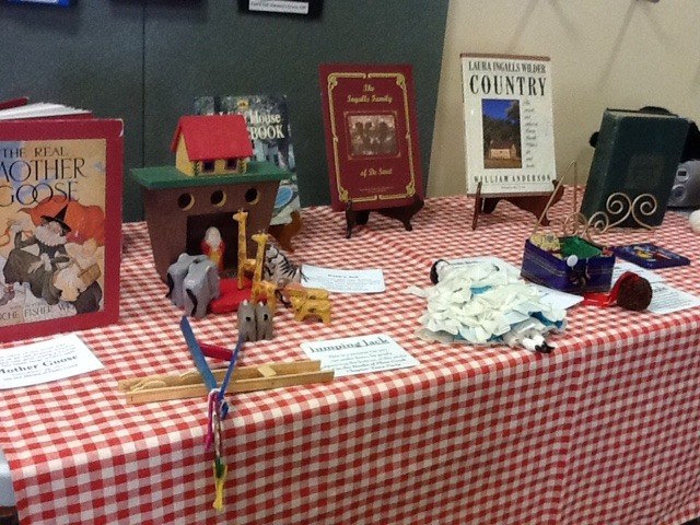 Little House on the Prairie replica and book display.