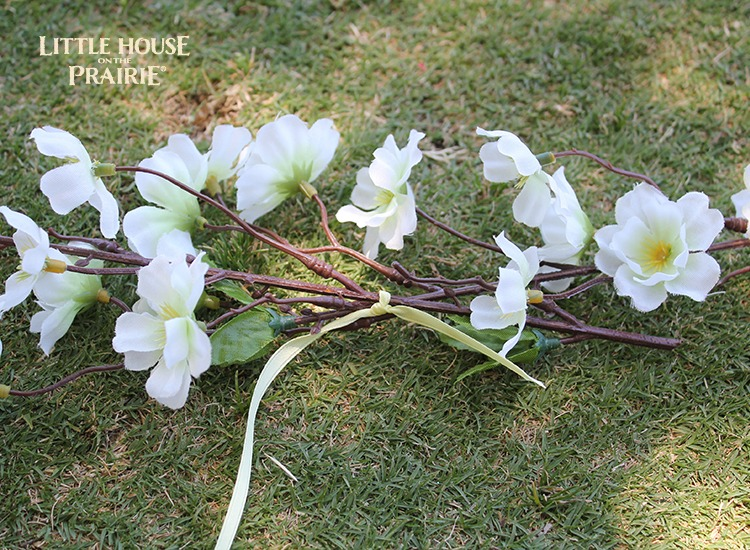 Securing the flower stems to form the basis of the flower hair wreath.