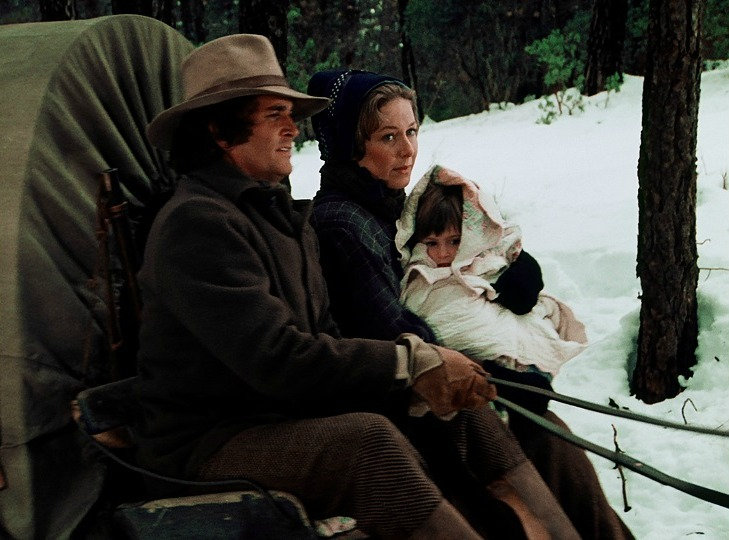 Baby Carrie wrapped in a quilt in the Little House on the Prairie Pilot.