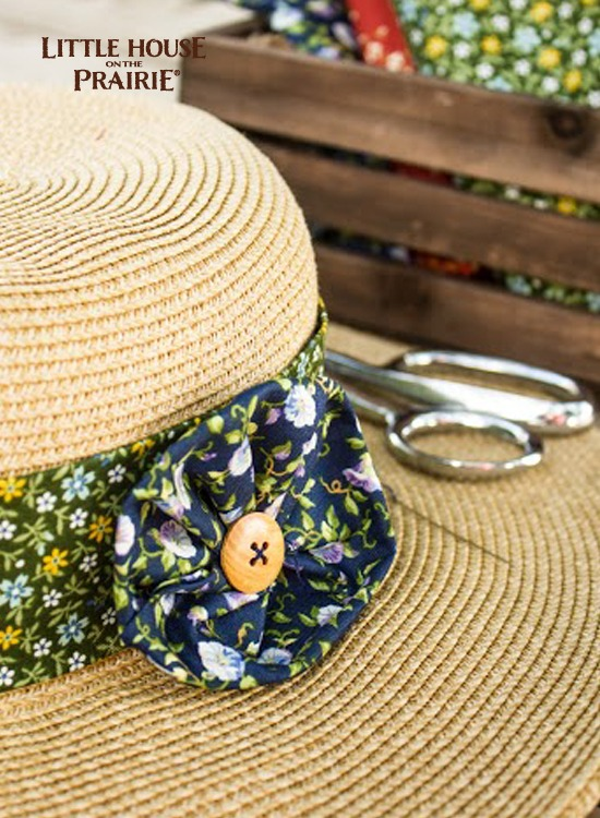 Adhere the flower embellishment directly to the hat or hatband. It's a little dressier than Ma Ingalls would have made but we think she would approve!