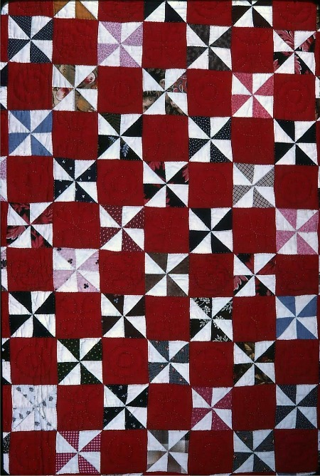Windmill Quilt Block Pattern: Squares are divided into triangles. Triangles are sewn together to make squares. Squares are joined together to make the Windmill Block.