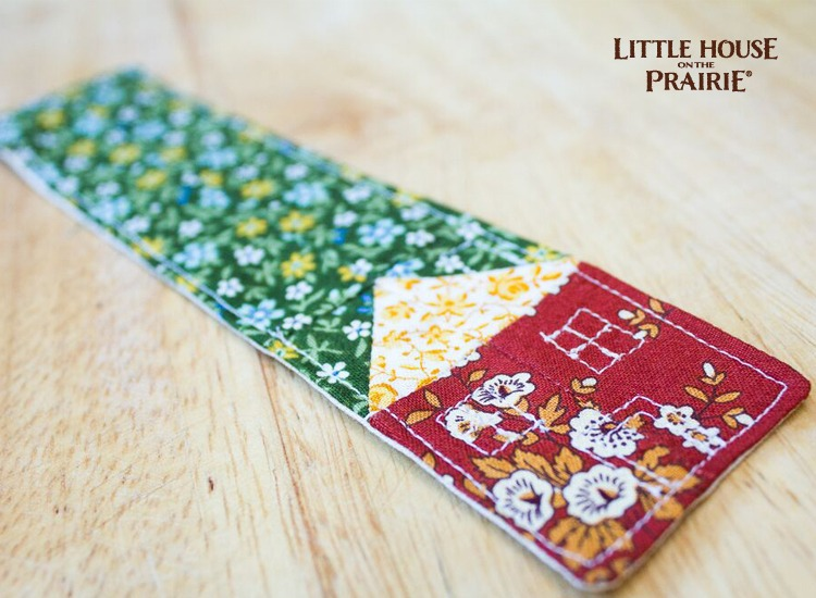 Simple, quilted house makes a fabric bookmark inspired by Little House on the Prairie.