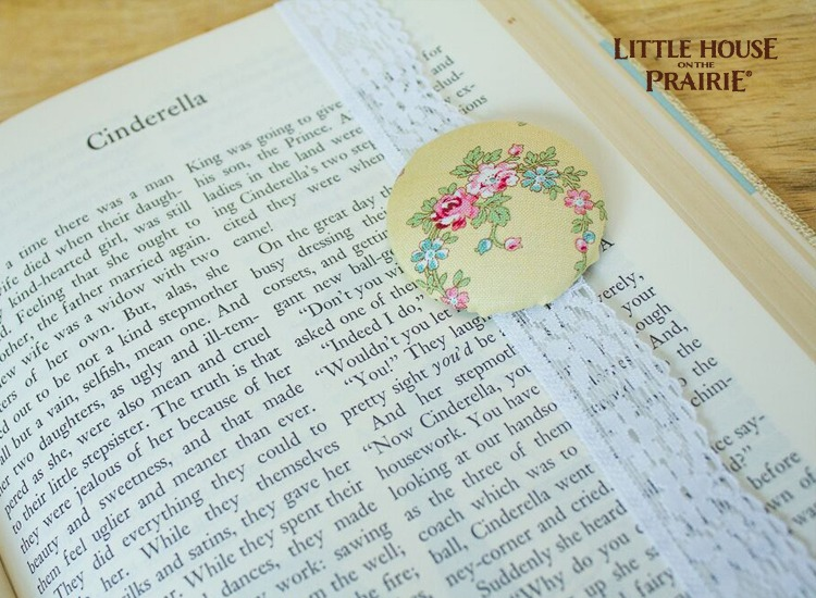 Fabric-covered button bookmark with old-fashioned lace.
