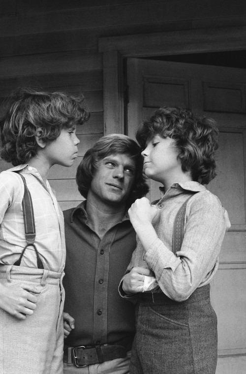 "LITTLE HOUSE ON THE PRAIRIE -- ""The Nephews"" Episode 14 -- Aired 1/19/81 -- Pictured: (l-r) Ham Larson as Myron Wilder, Dean Butler as Almanzo James Wilder, Rossie Harris as Rupert Wilder -- Photo by: NBCU Photo Bank"