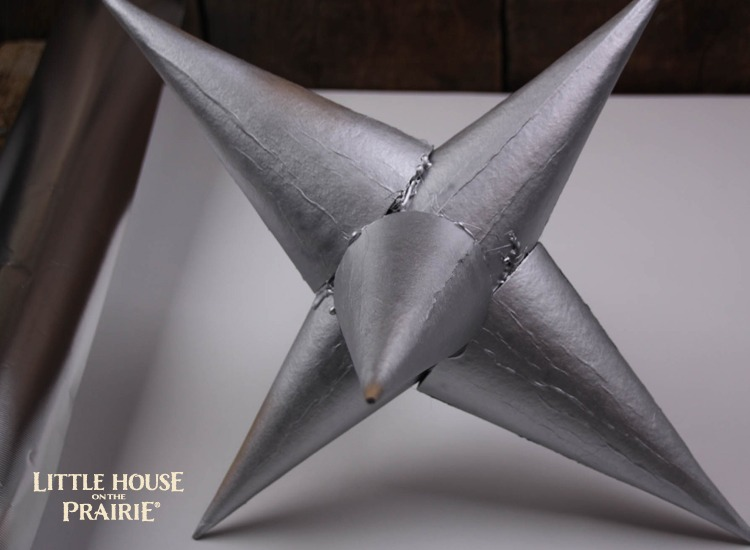 Make the star silver with paint or spray paint.
