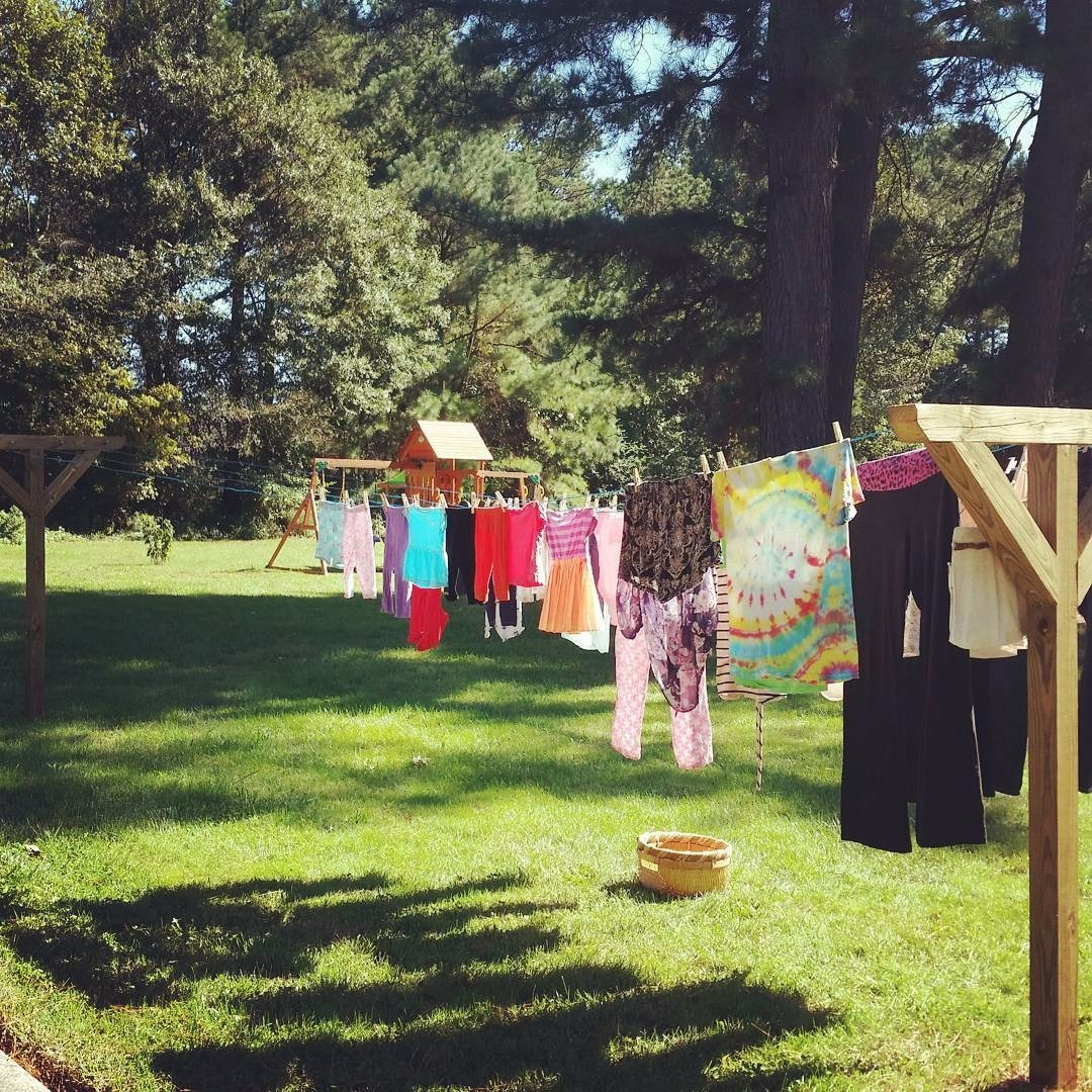 Frugal living makes a bright and cheerful #LittleHouseMoment with these colorful clothes on the line.