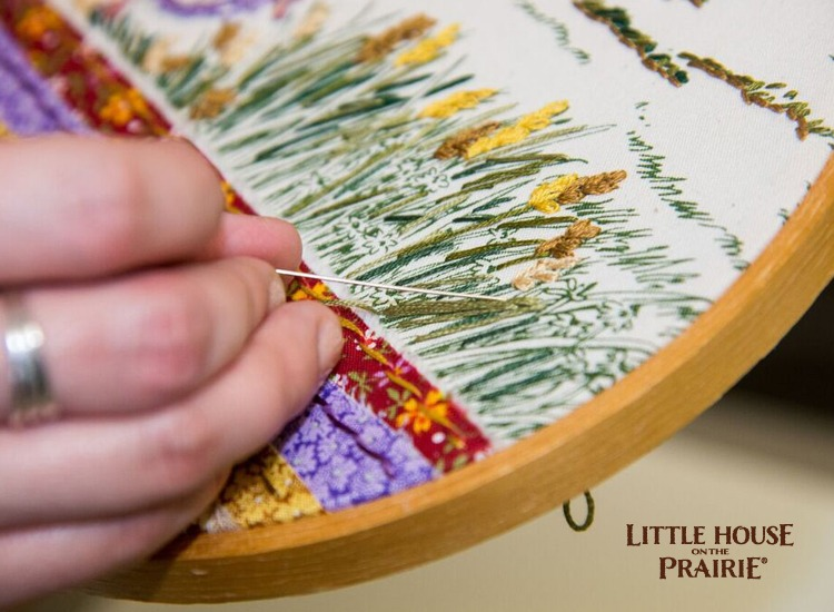 Embroidery details on a Little House on the Prairie inspired hoop project.