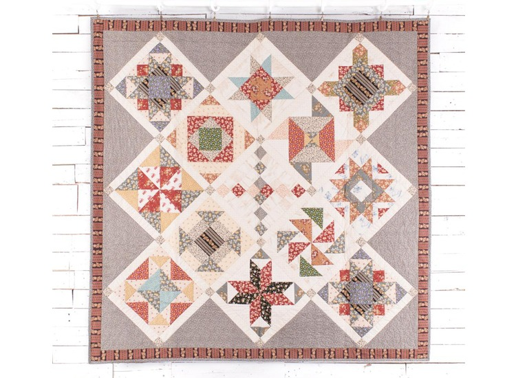Sample block styled quilt using Little House on the Prairie fabrics by Andover Fabrics