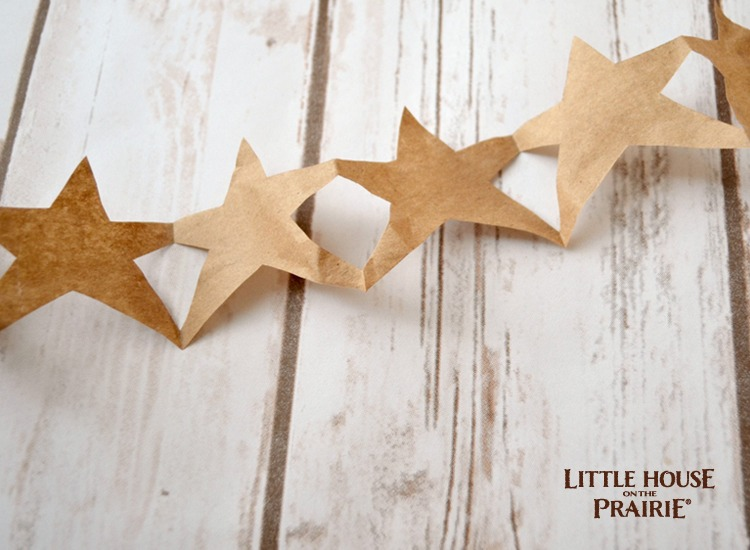 Homemade paper star garlands from the Little House on the Prairie books.