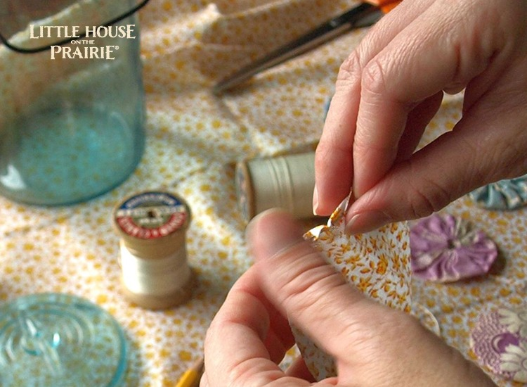 Use simple stiches around the edge of the fabric circle to begin creating your yo-yo shape.