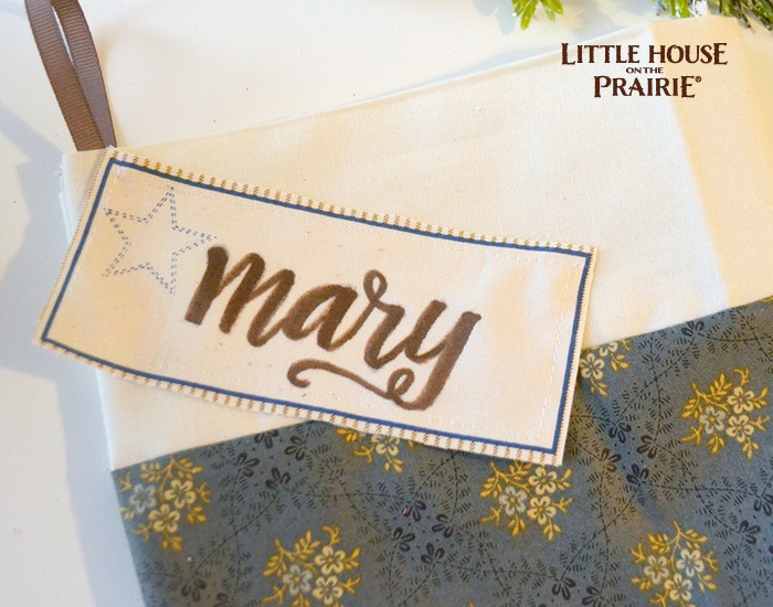 Hand lettering the tag for your homemade stocking.