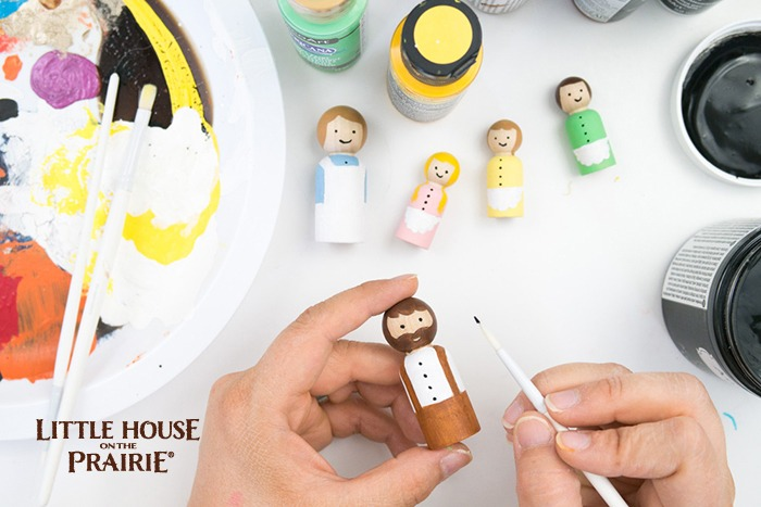 Painting the details on your Little House on the Prairie wooden peg dolls.