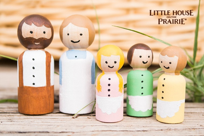 Finishing touches for your Little House on the Prairie inspired homemade wooden peg dolls.