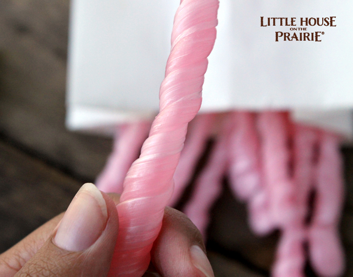 Twisting your Little House on the Prairie inspired homemade peppermint sticks.