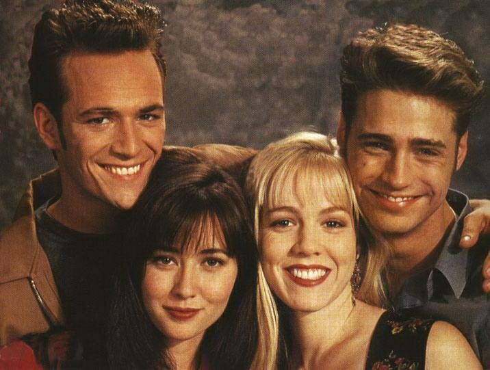 "Luke Perry, Shannen Doherty, Jennie Garth, and Jason Priestley in ""Beverly Hills, 90210"" (1990) (Photo by IMDb an Amazon Company)"